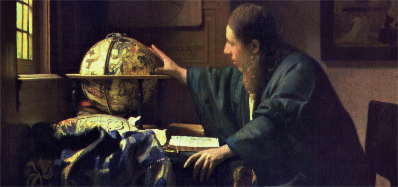 A man looking at an old globe