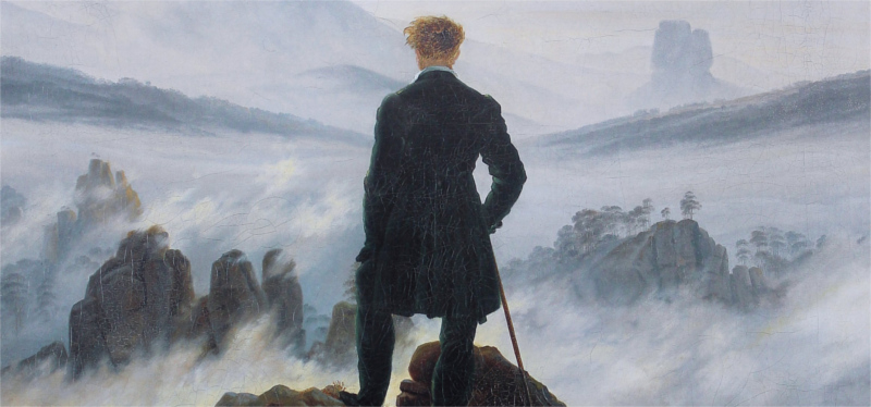 a man looking out from a mountain top