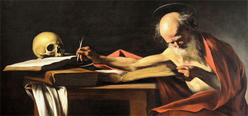 saint jerome writing at a desk with a skull on it