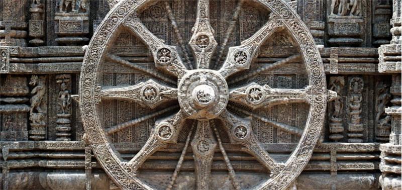 a dharmachakra (dharma wheel)