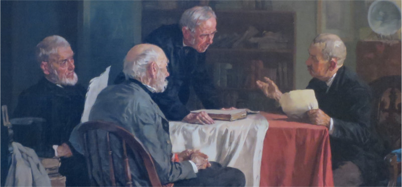 men discussing around a table