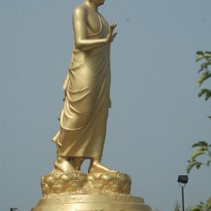 36 foot high brass image of the Buddha walking