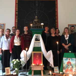 Gathering at Abhayaloka retreat centre Finland with shrine to remember Bhante