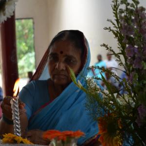 Dhni. Shantipriya placing offering to Shrine