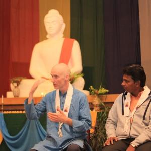 Dh Vidyaruchi addressing youth and translated by Dh. Yashosagar