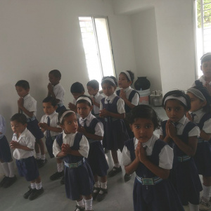 Students reciting their morning prayers in the Urygen Sangharakshita International School
