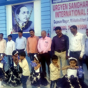 At the inauguration of the school: the founder, Sandeep Janardan Rakshit, is pictured in the centre in a pink shirt