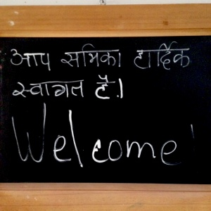 Hindi-English welcome at Adhisthana