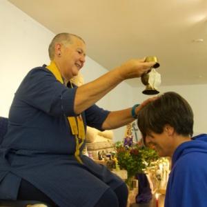 Hadayasiri receives the drops of purification