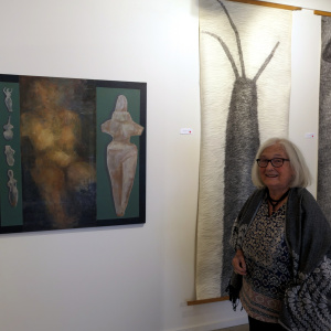 Anne Munz with her paintings and drawings