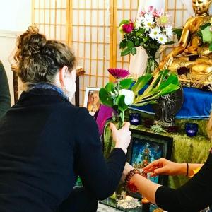 Meagan Offers Flowers
