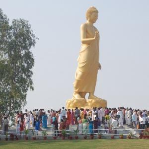 Pilgrims at Walking Buddha at Nagaloka