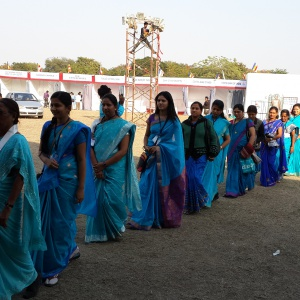 Men and Women walking towards shrine for Mitra ceremony.