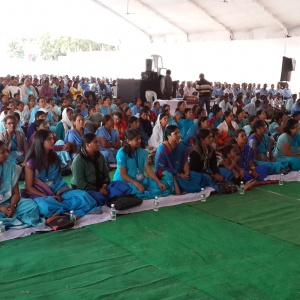Women sitting in a row for Mitra Ceremony