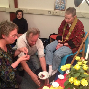 making a mala as a symbol of support from the sangha