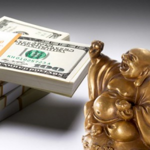 Buddha and dollar bills