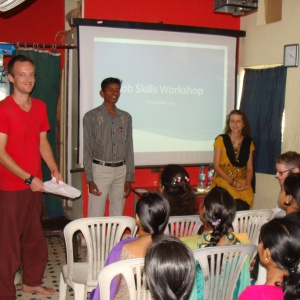 Paul and Helen at workshop and in middle Satish is translator...