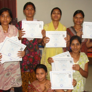 Women are showing their certificates of different IT courses i.e.  MS-office, Internet, Photoshop, Corel draw, Tally ERP 9, Hardware networking.