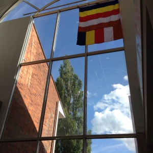 Buddhist flag hoisted above the library