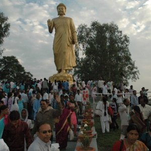 The 'Walking Buddha' statue with crowds