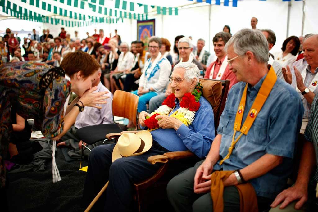 Sangharakshita receiving a garland on his 90th birthday