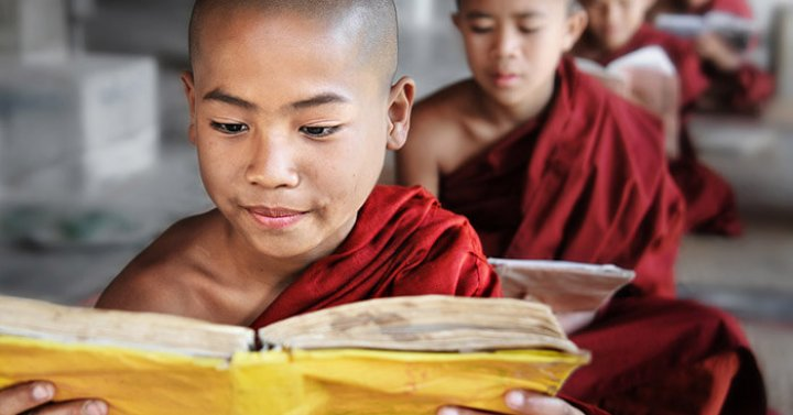 photo of Tibetan boy monk studying